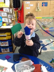 Artsmark Oldfield Primary SEND pupil making art