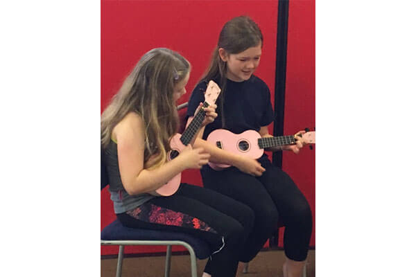 Ukulele-performance-indv-poppleton-primary-school-artsmark-visit-edit