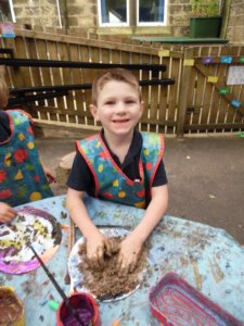 Artsmark Oldfield Primary pupil sculpting with clay