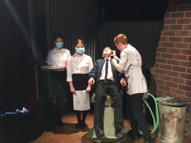 Artsmark Humberston academy pupils performing a play