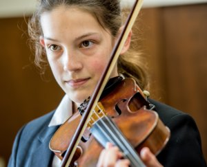 artsmark humberston academy student learning the violin