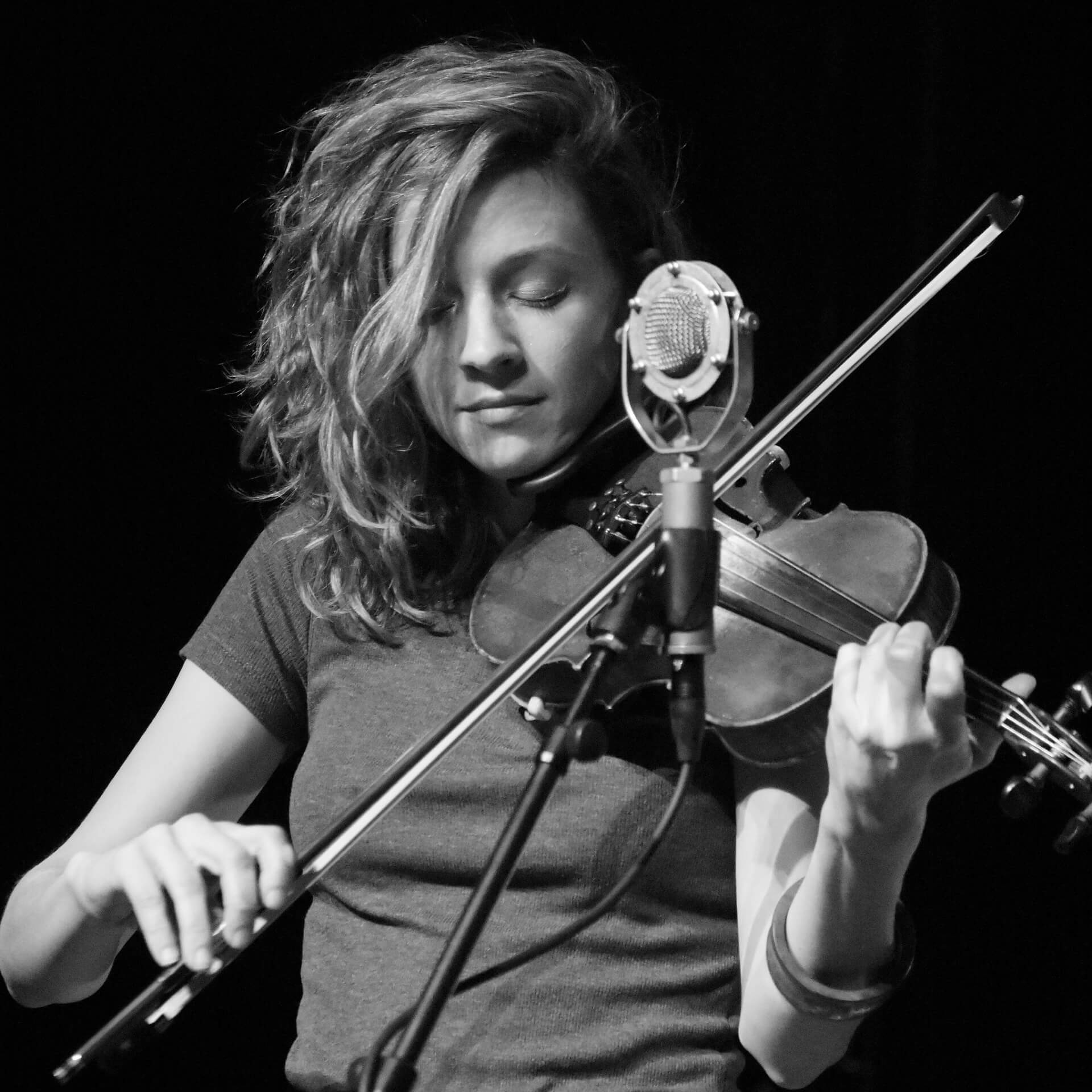 black and white photo of girl playing violin