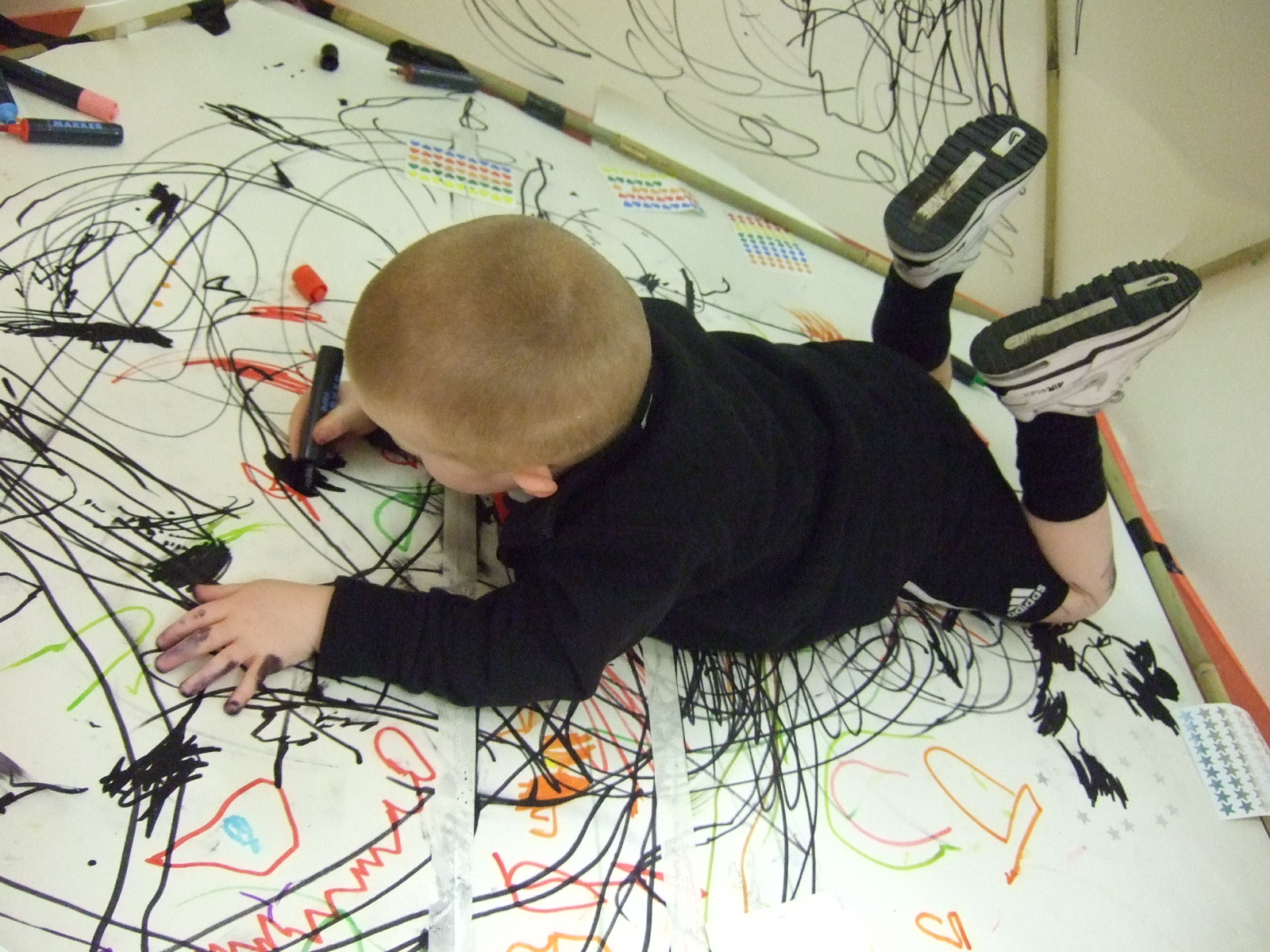 boy creating art on the floor