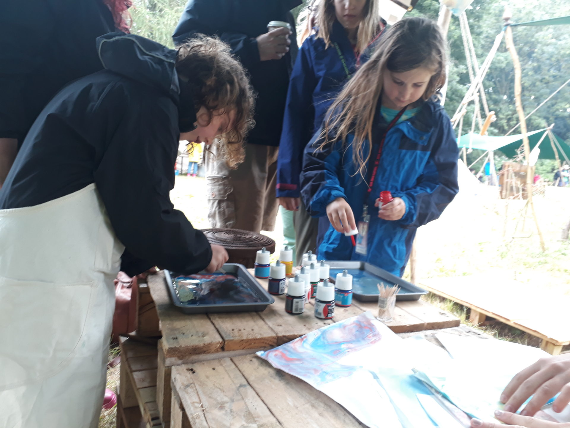 Young People taking part in the paper marbling activity in the WilderWild at Deer Shed