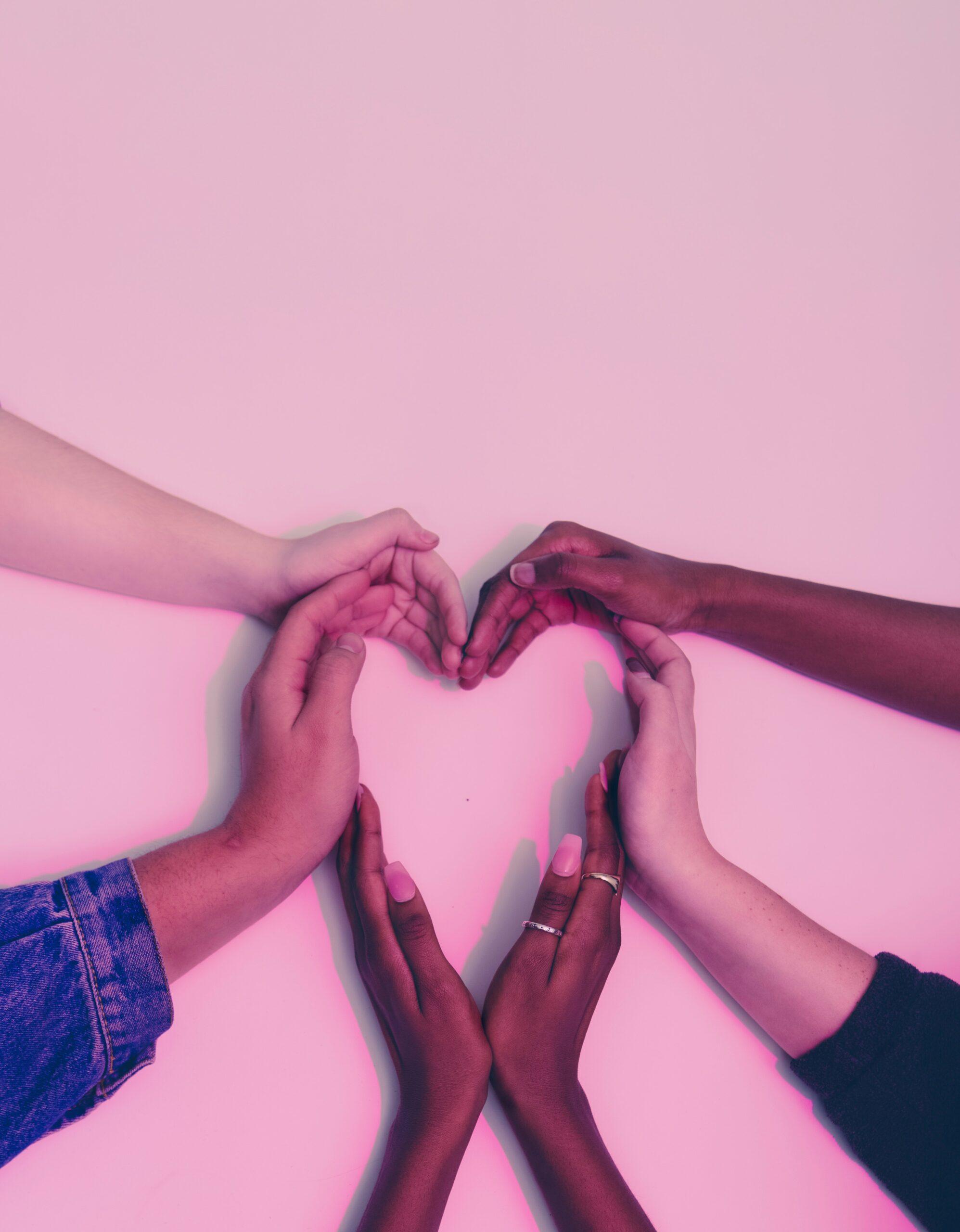 Hands together making heart shape