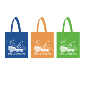 3 of the Bags of Creativity tote bags, one blue, one orange and one green
